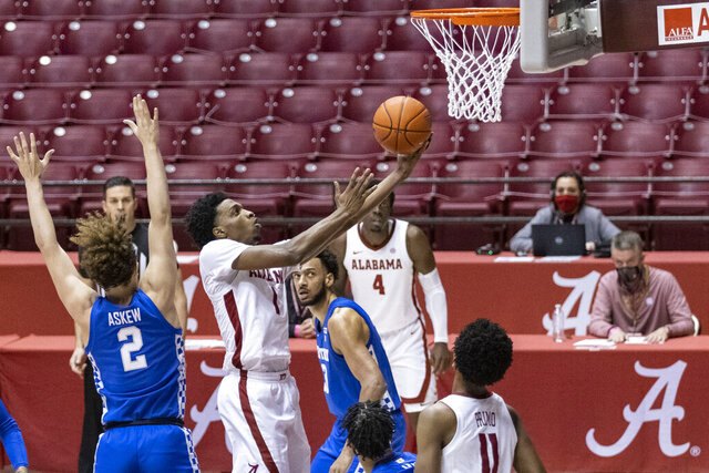 Alabama guard Herbert Jones (1) gets by Kentucky guard Devin Askew (2) for a shot during the second half of an NCAA college basketball game, Tuesday, Jan. 26, 2021, in Tuscaloosa, Ala. (AP Photo/Vasha Hunt)