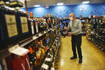 Mike Maruzzelli, of Tunkhannock, Pa., picks up a bottle of Campari liqueur at the Fine Wine & Good Spirits in Eaton Twp., Pa. Friday, May 22, 2020. Wyoming County and liquor stores were included on the list of counties in the state that could reopen under Gov. Tom Wolf's plan after the COVID-19 pandemic closed many businesses. (Sean McKeag/The Citizens' Voice via AP)