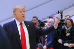 U.S. President Donald Trump leaves the World Economic Forum in Davos, Switzerland, Wednesday, Jan. 22, 2020. Trump's two-day stay in Davos is a test of his ability to balance anger over being impeached with a desire to project leadership on the world stage. (AP Photo/Markus Schreiber)