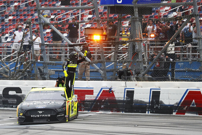 Ryan Blaney (12) celebrates after winning a NASCAR Cup Series auto race at Talladega Superspeedway in Talladega Ala., Monday, June 22, 2020. (AP Photo/John Bazemore)