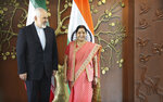 Iranian Foreign Minister Mohammad Javad Zarif, left, talks with his Indian counterpart Sushma Swaraj during a photo call before their meeting in New Delhi, India, Tuesday, May 14, 2019. (Zarif's visit to New Delhi comes within days of the United States ending its waiver to India that allowed it to buy Iranian oil without facing American sanctions. (AP Photo/Manish Swarup)