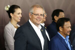 FILE - In this Nov. 18, 2019, file photo, Australia's Prime Minister Scott Morrison, center, poses for a group photo at APEC Haus in Port Moresby, Papua New Guinea. Australia. Saturday, May 18, 2019 is the last possible date that Morrison could have realistically chosen to hold an election. (AP Photo/Mark Schiefelbein, File)