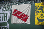 A banner is partially covered before an MLS soccer match between the Portland Timbers and the Seattle Sounders on Friday, Aug. 23, 2019, in Portland, Ore. Major League Soccer recently instituted a policy that bans political displays at matches. (Serena Morones/The Oregonian via AP)
