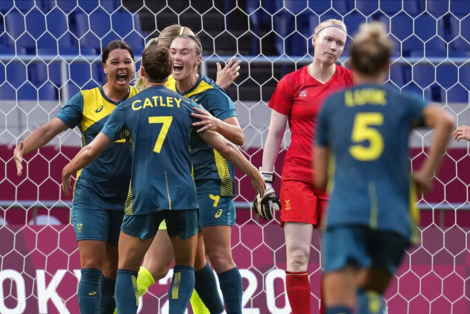 Australia players celebrate for a goal during a women's soccer match against Sweden at the 2020 Summer Olympics, Saturday, July 24, 2021, in Saitama, Japan. (AP Photo/Martin Mejia)