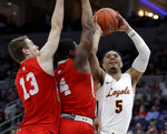 Loyola of Chicago's Marques Townes (5) heads to the basket as Bradley's Armon Brummett (4) and Luuk van Bree (13) defend during the first half of an NCAA college basketball game in the semifinal round of the Missouri Valley Conference tournament, Saturday, March 9, 2019, in St. Louis. (AP Photo/Jeff Roberson)