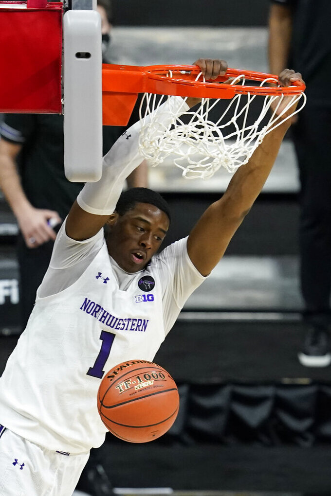 Northwestern's Chase Audige dunks during the second half of an NCAA college basketball game against Minnesota at the Big Ten Conference tournament, Wednesday, March 10, 2021, in Indianapolis. (AP Photo/Darron Cummings)