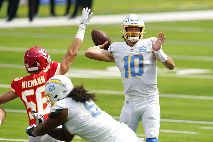 Los Angeles Chargers quarterback Justin Herbert (10) throws against the Kansas City Chiefs during the first half of an NFL football game Sunday, Sept. 20, 2020, in Inglewood, Calif. (AP Photo/Ashley Landis)