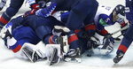 Great Britain's Ben Davies, right, reaches for the puck during the Ice Hockey World Championships group A match between the United States and Great Britain at the Steel Arena in Kosice, Slovakia, Wednesday, May 15, 2019. (AP Photo/Petr David Josek)