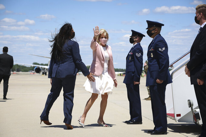 First lady Jill Biden waves as she walks to board an aircraft at Andrews Air Force Base, Md., Thursday, May 13, 2021. Biden is traveling to West Virginia. (Oliver Contreras/The New York Times via AP, Pool)