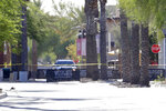 The Westgate retail district is closed off Thursday, May 21, 2020, in Glendale, Ariz. Police say one person is in critical condition and two others were injured in a shooting Wednesday evening near the shopping and entertainment district west of Phoenix. A Glendale police spokeswoman said Wednesday that the suspect was taken into custody safely. (AP Photo/Matt York)