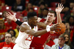 Maryland forward Bruno Fernando, left, of Angola, drives past Wisconsin forward Ethan Happ in the first half of an NCAA college basketball game, Monday, Jan. 14, 2019, in College Park, Md. (AP Photo/Patrick Semansky)