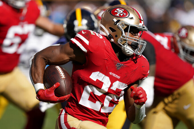 San Francisco 49ers running back Matt Breida (22) runs against the Pittsburgh Steelers during the second half of an NFL football game in Santa Clara, Calif., Sunday, Sept. 22, 2019. (AP Photo/Tony Avelar)