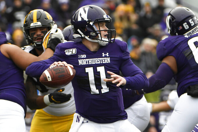 Northwestern quarterback Aidan Smith (11) passes against Iowa during the first half of an NCAA college football game, Saturday, Oct. 26, 2019, in Evanston, Ill. (AP Photo/David Banks)