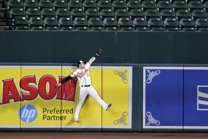 Baltimore Orioles center fielder Austin Hays makes the catch at the wall on a ball hit by Toronto Blue Jays' Vladimir Guerrero Jr. during the fourth inning of a baseball game Thursday, Sept. 19, 2019, in Baltimore. (AP Photo/Julio Cortez)