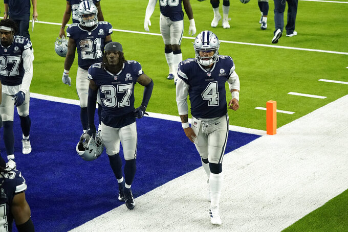 The Dallas Cowboys including Dak Prescott (4) and Donovan Wilson (37) walk off the field after a loss to the Los Angeles Rams during an NFL football game Sunday, Sept. 13, 2020, in Inglewood, Calif. (AP Photo/Ashley Landis )