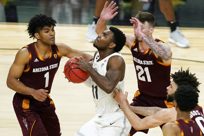 Oregon's Amauri Hardy (11) drives into Arizona State's Remy Martin (1) and Chris Osten (21) during the second half of an NCAA college basketball game in the quarterfinal round of the Pac-12 men's tournament Thursday, March 11, 2021, in Las Vegas. (AP Photo/John Locher)