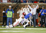 Houston cornerback Isaiah Johnson (14) tackles SMU wide receiver Reggie Roberson Jr. (21) during the first half of an NCAA college football game Saturday, Nov. 3, 2018, in Dallas. (AP Photo/Brandon Wade)