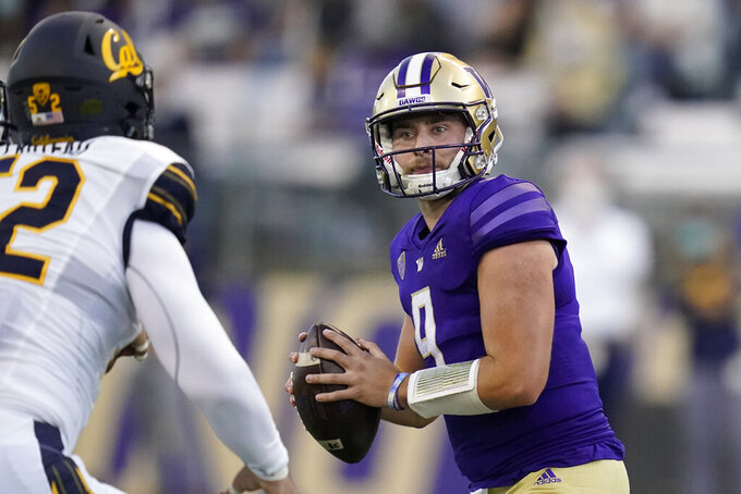 Washington quarterback Dylan Morris drops to pass against California during the first half of an NCAA college football game, Saturday, Sept. 25, 2021, in Seattle. (AP Photo/Elaine Thompson)