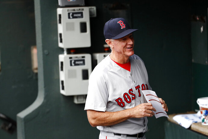 FILE - In this July 23, 2018, file photo, Boston Red Sox bench coach Ron Roenicke stands in the dugout before a baseball game against the Baltimore Orioles in Baltimore.  The Red Sox  announced on Tuesday, Feb. 11, 2020, that Roenicke has been named interim manager. He takes over from Alex Cora, who was let go for directing the sign-stealing scheme with the Houston Astros in 2017, the year before he took over in Boston.  (AP Photo/Patrick Semansky, File)