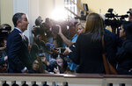Virginia Governor Ralph Northam, left, is surrounded by media outside his office at the State Capitol in Richmond, Va., Wednesday, Nov. 6, 2019. Northam had just left a meeting with his Cabinet and was questioned about the previous night's election results which gave Democrats control of the Virginia House of Delegates and Senate. (Bob Brown/Richmond Times-Dispatch via AP)