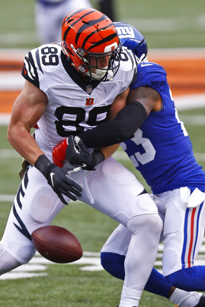 Cincinnati Bengals tight end Drew Sample (89) fumbles the ball against New York Giants free safety Logan Ryan (23) during the second half of NFL football game, Sunday, Nov. 29, 2020, in Cincinnati. Ryan recovered the ball. (AP Photo/Aaron Doster)