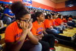 Doyle-Ryder sixth-grader Brea King, 12, listens intently as Tech billionaire Elon Musk talks with hundreds of Flint students on Friday, March 22, 2019 at Doyle-Ryder Elementary School in Flint. Musk is providing a Chromebooks for every seventh-grader in the 2019-20 school year and will provide water filtration systems to be installed in all Flint schools.