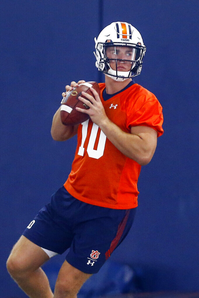 FILE - In this Aug. 2, 2019, file photo, Bo Nix throws a pass during Auburn's first practice in Auburn, Ala. He's the nation's No. 1 dual-threat quarterback and No. 33 overall prospect in his class according to the 247Sports Composite. (AP Photo/Butch Dill, File)