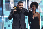 Drake accepts the award for best rap song for