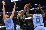 Boston Celtics forward Jayson Tatum, center, controls the ball between Memphis Grizzlies center Marc Gasol (33) and forward JaMychal Green, right, during the second half of an NBA basketball game Saturday, Dec. 29, 2018, in Memphis, Tenn. (AP Photo/Brandon Dill)