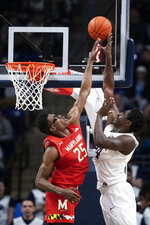 Penn State forward Mike Watkins (24) shoots over Maryland forward Jalen Smith (25) in the first half of an NCAA college basketball game in State College, Pa., on Tuesday, Dec. 10, 2019. (AP Photo/Barry Reeger)