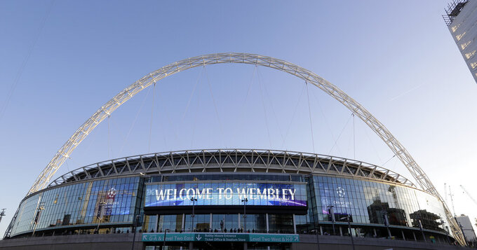 FILE - This Oct. 3, 2018 file photo shows a view of the exterior of Wembley Stadium in London. Supporters will attend soccer in Britain on Friday, July 31, 2020 for the first time since the country's coronavirus lockdown four months ago. In a pilot event for the planned widespread return of supporters, 500 will be allowed into the Irish Cup final at 18,500-capacity Windsor Park. Northern Ireland is ahead of the rest of the U.K. Over in London on Saturday, England's FA Cup final will be played without any spectators at Wembley. (AP Photo/Kirsty Wigglesworth, File)