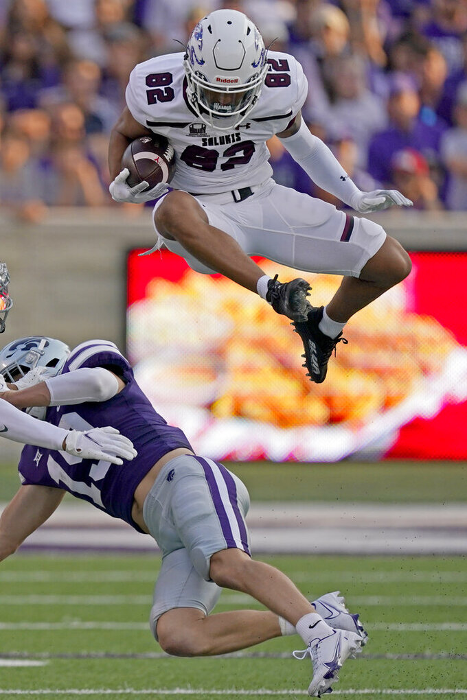 Southern Illinois wide receiver Izaiah Hartrup (82) jumps over Kansas State defensive back Ross Elder (19) during the first half of an NCAA college football game, Saturday, Sept. 11, 2021, in Manhattan, Kan. (AP Photo/Charlie Riedel)
