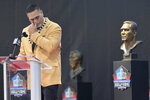 Former NFL player Kevin Mawae pauses as he speaks during the induction ceremony at the Pro Football Hall of Fame, Saturday, Aug. 3, 2019, in Canton, Ohio. (AP Photo/David Richard)