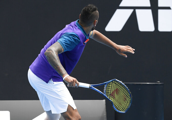Australia's Nick Kyrgios prepares to throw his racket into the stands during his match against Croatia's Borna Coric at a tuneup event ahead of the Australian Open tennis championships in Melbourne, Australia, Friday, Feb. 5, 2021.(AP Photo/Andy Brownbill)