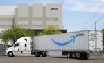 FILE - This July 17, 2019, file photo shows an Amazon shipping truck at a fulfillment center in Phoenix. Amazon.com Inc. reports financial earns on Thursday, Oct. 24. (AP Photo/Ross D. Franklin, File)
