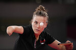 Poland's Natalia Partyka competes during the table tennis women's singles first round match against Australia's Michelle Bromley at the 2020 Summer Olympics, Saturday, July 24, 2021, in Tokyo. (AP Photo/Kin Cheung)