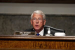 Senate Commerce, Science and Transportation Committee Chairman Roger Wicker, R-Miss., speaks as Federal Aviation Administration administrator Stephen Dickson testifies during a hearing of the Senate Commerce, Science, and Transportation Committee on Capitol Hill on Wednesday, June 17, 2020, in Washington. (Graeme Jennings/Pool via AP)