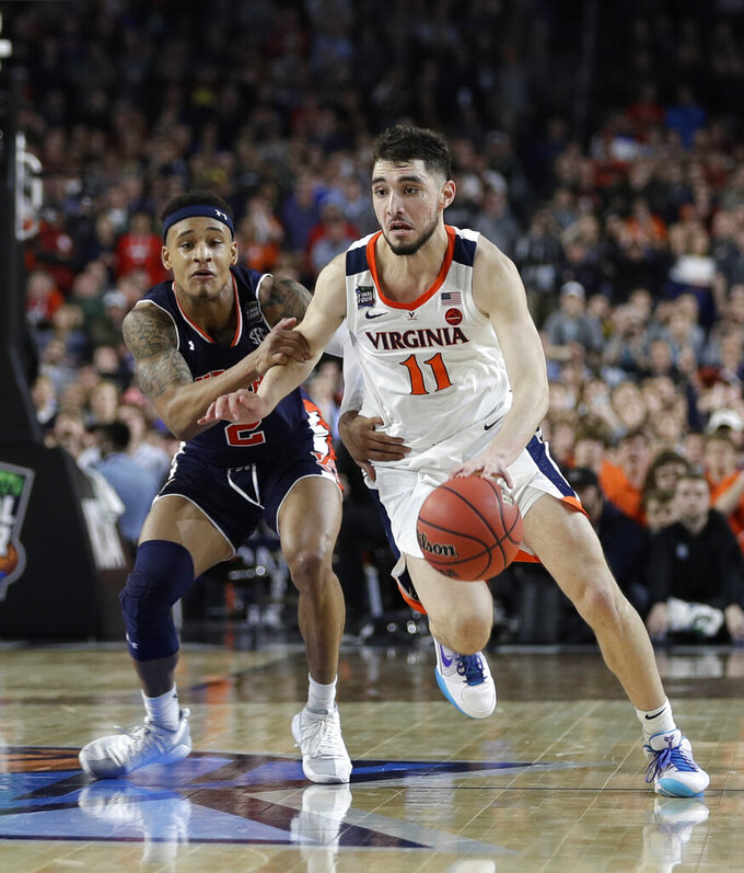 Virginia guard Ty Jerome (11) drives up court ahead of Auburn guard Bryce Brown during the second half in the semifinals of the Final Four NCAA college basketball tournament, Saturday, April 6, 2019, in Minneapolis. (AP Photo/David J. Phillip)