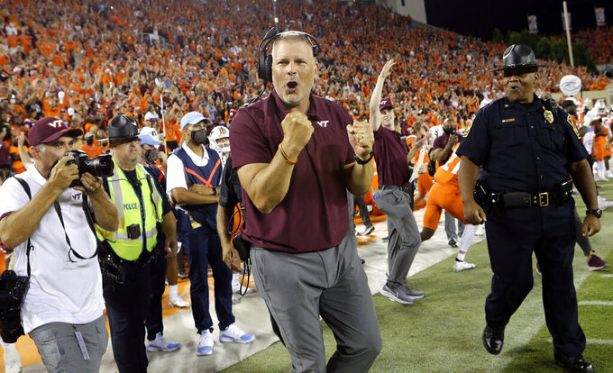 Virginia Tech coach Justin Fuente celebrates in the final moments of the team's win over North Carolina in an NCAA college football game Friday, Sept. 3, 2021, in Blacksburg, Va. (Matt Gentry/The Roanoke Times via AP)