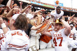 Texas Longhorns tight end Andrew Beck (47) wears the Golden Hat and celebrates with fans after defeating Oklahoma 48-45 in an NCAA college football game at the Cotton Bowl, Saturday, Oct. 6, 2018, in Dallas. (AP Photo/Cooper Neill)