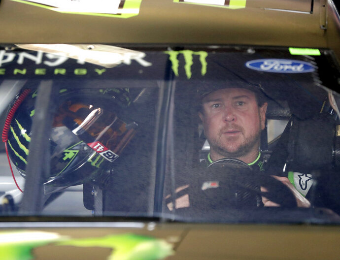 Kurt Busch sits behind the wheel of his car as he waits to go out on the track during a NASCAR auto racing practice session at Daytona International Speedway, Saturday, Feb. 10, 2018, in Daytona Beach, Fla. (AP Photo/John Raoux)