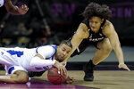 South Carolina's Alanzo Frink, left, and Tulsa's Darien Jackson battle for a loose ball during the second half of an NCAA college basketball game Sunday, Nov. 29, 2020, at the T-Mobile Center in Kansas City, Mo. (AP Photo/Charlie Riedel)
