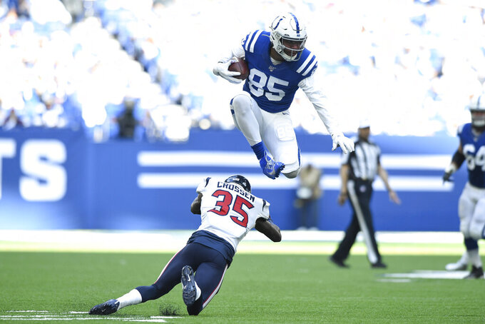 Indianapolis Colts' Eric Ebron (85) leaps over Houston Texans' Keion Crossen (35) during the second half of an NFL football game, Sunday, Oct. 20, 2019, in Indianapolis. (AP Photo/Doug McSchooler)