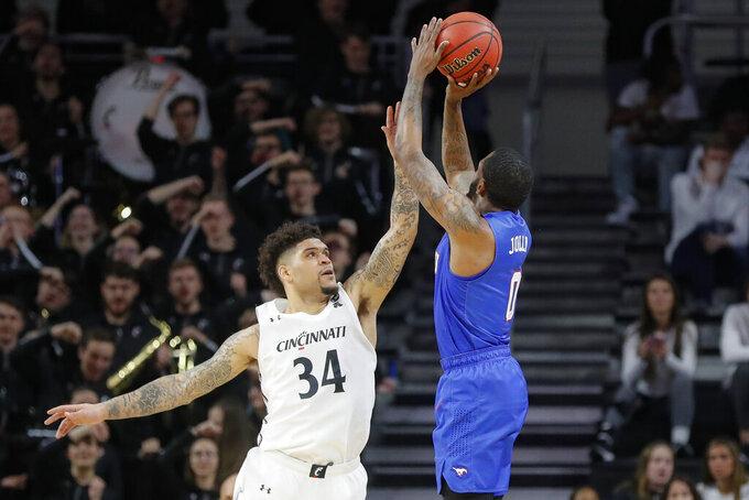 SMU's Tyson Jolly (0) shoots over Cincinnati's Jarron Cumberland (34) during the second half of an NCAA college basketball game Tuesday, Jan. 28, 2020, in Cincinnati. (AP Photo/John Minchillo)