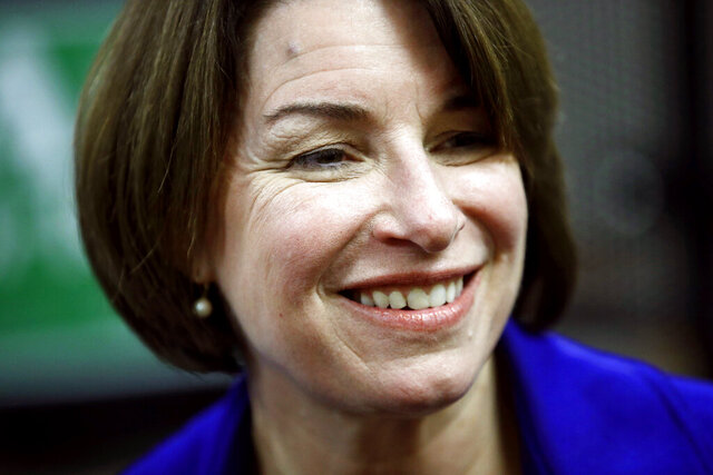 Democratic presidential candidate Sen. Amy Klobuchar, D-Minn., visits with attendees after speaking at a campaign event, Sunday, Jan. 19, 2020, in Des Moines, Iowa. (AP Photo/Patrick Semansky)