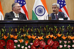 U.S. Secretary of State Mike Pompeo, left, attends a news conference with Indian counterpart Subrahmanyam Jaishankar, at the Foreign Ministry in New Delhi, India, Wednesday, June 26, 2019. Pompeo held meetings in India's capital on Wednesday amid growing tensions over trade and tariffs that has strained the partners' ties. (AP Photo/Jacquelyn Martin, Pool)