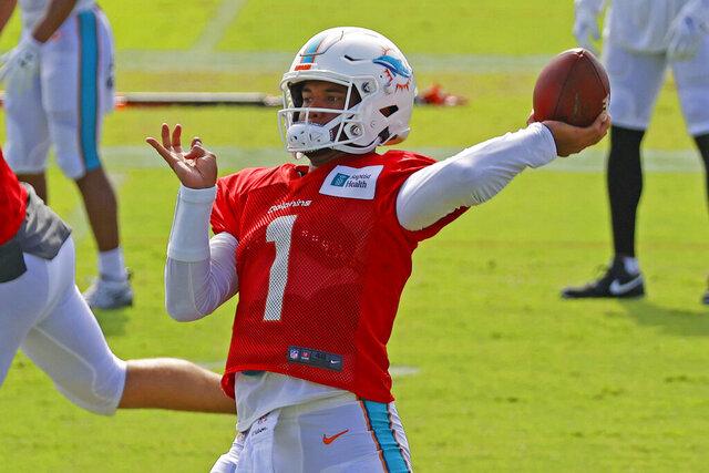 Miami Dolphins quarterback Tua Tagovailoa (1) throws the ball during an NFL football training camp practice in Davie, Fla., Monday, Aug. 17, 2020. (AP Photo/Joel Auerbach)