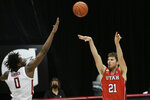 Utah forward Riley Battin (21) shoots over Washington State center Efe Abogidi (0) during the second half of an NCAA college basketball game in Pullman, Wash., Thursday, Jan. 21, 2021. (AP Photo/Young Kwak)