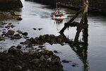 In this picture taken Tuesday, Sept 3, 2019, a fisherman boat enters the port of Eyemouth, south coast of Edinburgh, Scotland. In their drive to uncouple Britain from the European Union, pro-Brexit campaigners have turned fishing into one of their battlegrounds. But while some seafood industry workers want out of the EU, others are alarmed at the prospect of losing frictionless access to EU consumers. (AP Photo/Francois Mori)