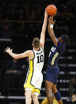 Iowa guard Joe Wieskamp (10) blocks a shot by Oral Roberts guard Deondre Burns during the first half of an NCAA college basketball game, Friday, Nov. 15, 2019, in Iowa City, Iowa. (AP Photo/Charlie Neibergall)